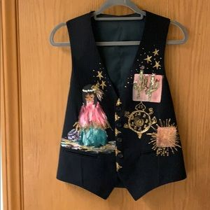Hand painted vest with Native American designs.